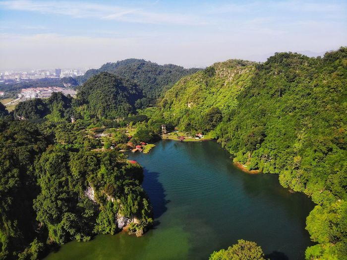 Aerial panorama view of gunung lang in ipoh, perak High Angle View Aerial Photography Lake Beautiful Travel Travel Destinations Landmark Eyeemphotography Perak EyeEm Selects EyeEm Gallery Outdoors Green Business Tree Water Tea Crop Forest Rural Scene Mountain Summer Sky Landscape Green Color Calm Aerial View Tourism Tourist Attraction  Lakeside Famous Place