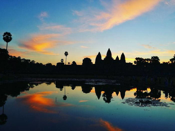 Sunrise Reflection Travel Travel Destinations Tourism Water Architecture Landscape Religion Place Of Worship Tranquility History Vacations Reflection Lake No People Outdoors Cambodia