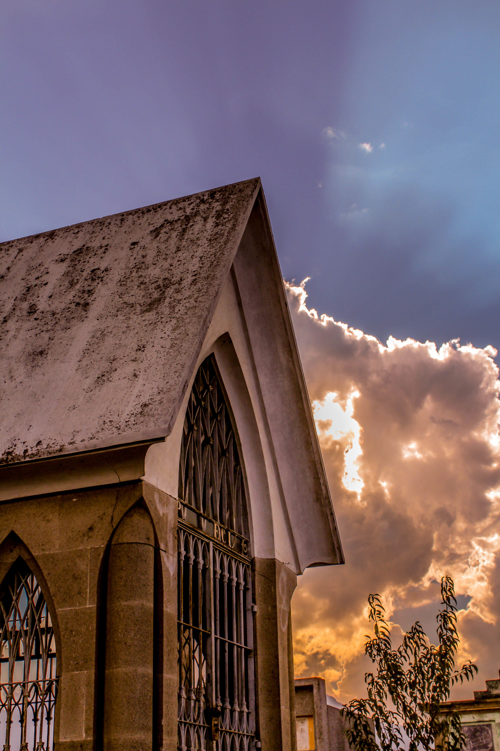 architecture, built structure, building exterior, low angle view, sky, cloud - sky, building, window, cloud, high section, outdoors, arch, no people, residential building, residential structure, house, facade, day, sunlight, city