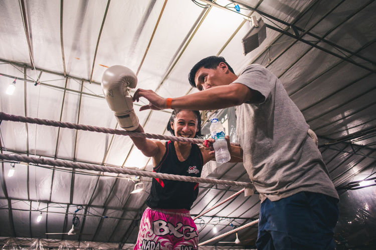 Only when you've been in the ring yourself will you truly understand that expression of relief and joy. International Women's Day 2019 Strength People Lifestyles Boxing - Sport Punching Young Adult Sport Arms Raised Exercising Real People Winner Young Woman Happiness Joy Victory Women Sportswoman