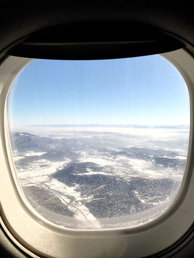Airplane Window Sky Transportation Scenics Aerial View Landscape Journey Travel Vehicle Interior Nature Snow Mode Of Transport Air Vehicle Day Flying Beauty In Nature Aircraft Wing Cold Temperature No People