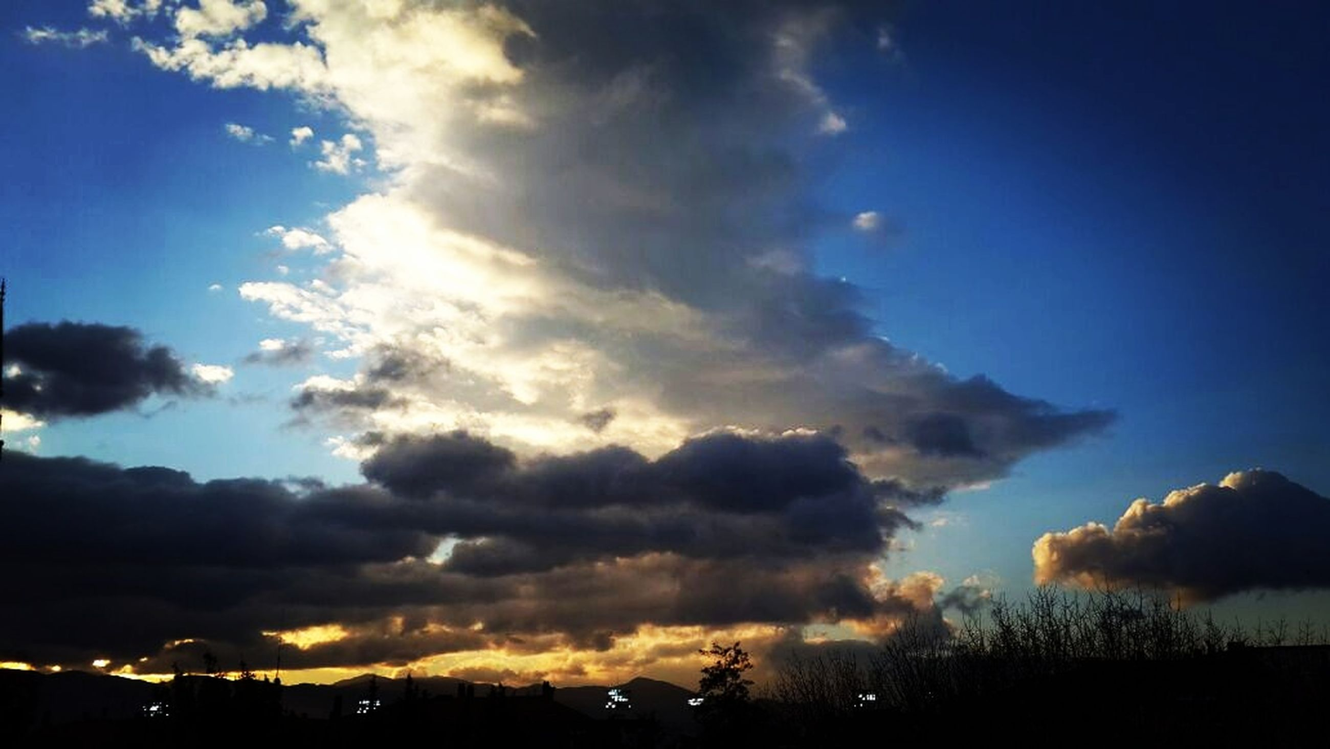 sky, cloud - sky, beauty in nature, sunbeam, scenics, nature, idyllic, sunset, outdoors, no people, silhouette, tranquility, storm cloud, day