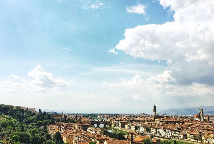 Distant view of duomo santa maria del fiore in city against sky