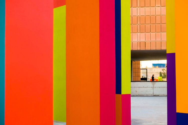Abstract geometric pattern on concrete wall Architectural Column Architecture Building Built Structure Close-up Creativity Day Flooring Illuminated Incidental People Indoors  Modern Multi Colored Orange Color People Vibrant Color Wall - Building Feature Yellow