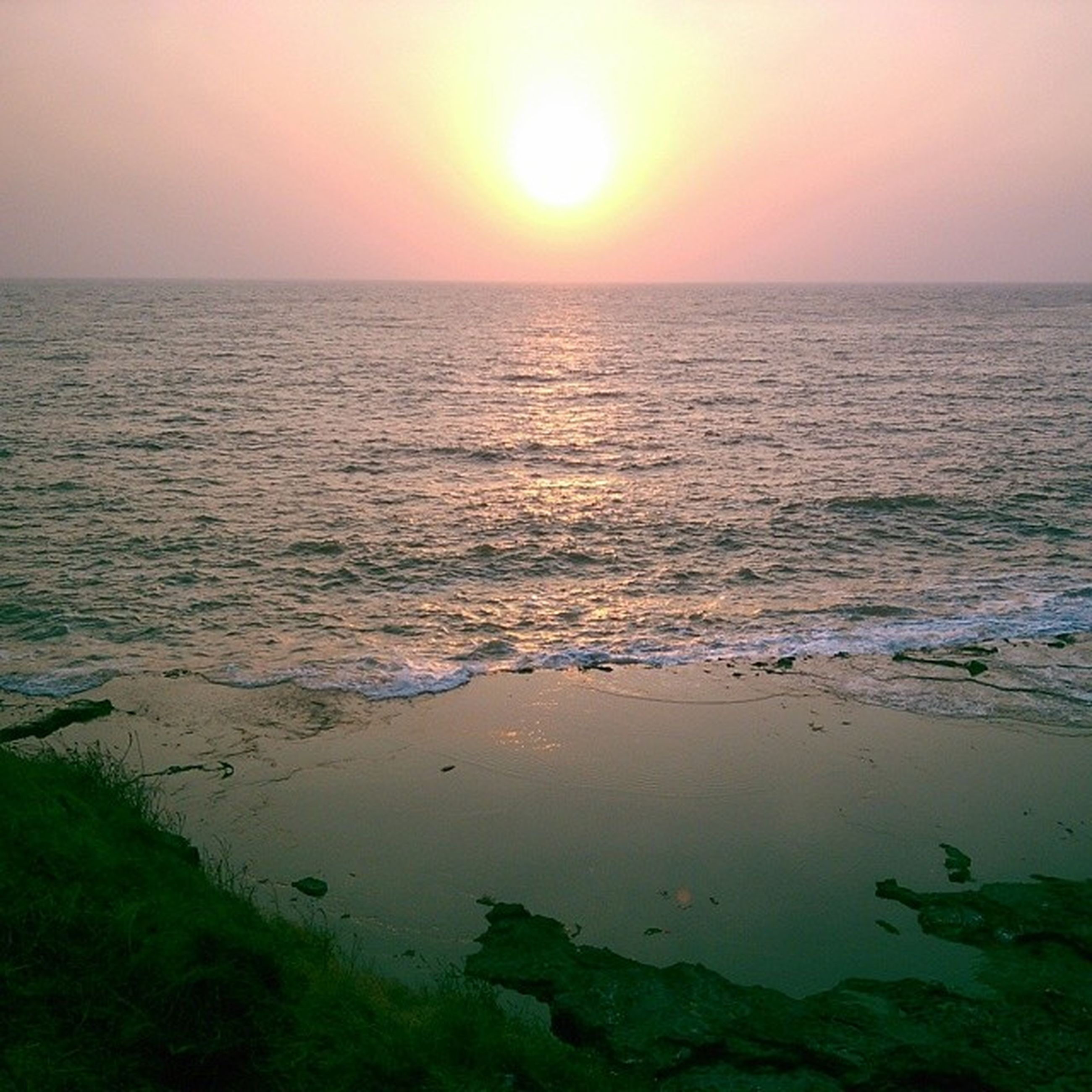 sea, water, horizon over water, sunset, tranquil scene, scenics, tranquility, beauty in nature, sun, reflection, idyllic, nature, beach, seascape, sky, shore, clear sky, orange color, sunlight, rippled
