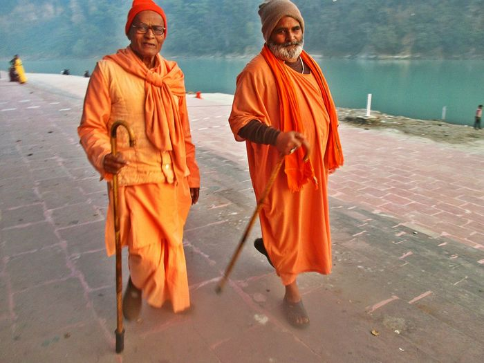Senior Adult Looking At Camera Portrait Men Adult Outdoors Only Men Senior Men River Bank  Two Adult Walking Indian Monestary Old People Yet Happy Random People Smiling🇮🇳 India River The Ganga At Rishikesh Day random shot No Edit/no Filter Mountain And River