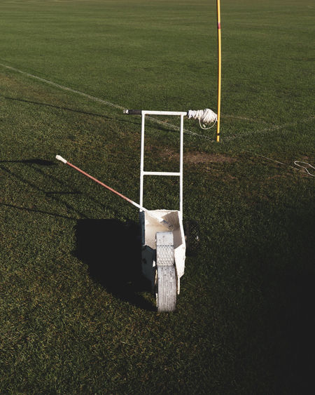 soccer field line marker Soccer Field Stadium Lines Grass Tartan Track Sport No People Nature Playing Field Absence Green Color High Angle View White Color Metal Varnish White Marks Soccer Field Lines Competition Lime Environment