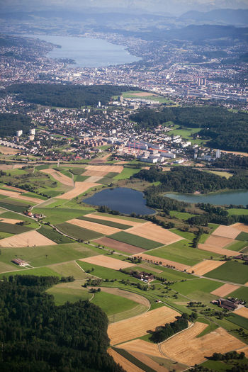 Aerial view of patches of cultivated land and houses