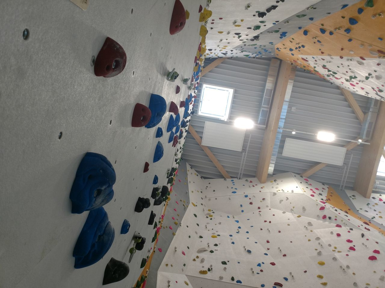 climbing wall, indoors, health club, climbing, extreme sports, sport, rock climbing, adventure, low angle view, illuminated, exercising, gym, challenge, day, no people
