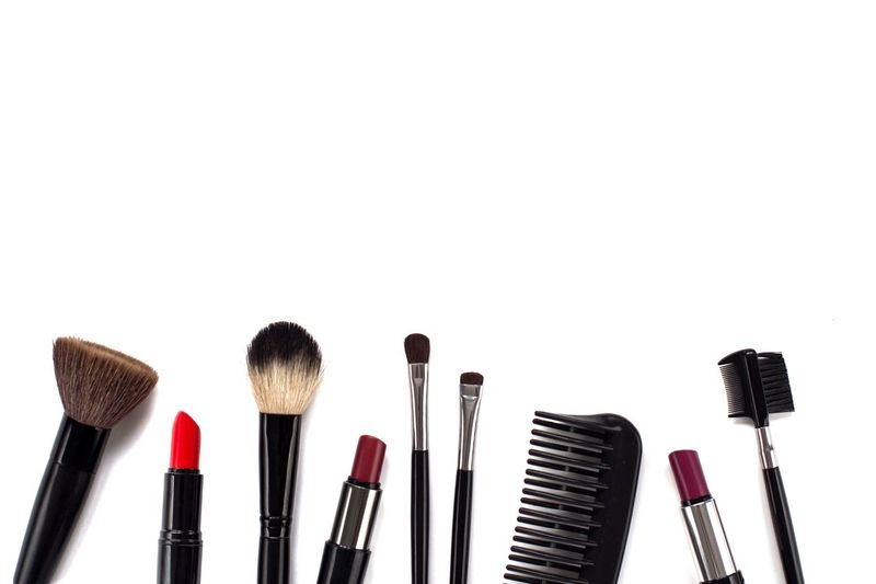 Lipsticks and makeup brushes on white background Fashion Beauty Product Flat Lay Makeupartist Lipstick Cosmetics Red Lipstick Make-up Brush White Background Cut Out Copy Space In A Row Creativity Black Color Brush Close-up Make-up
