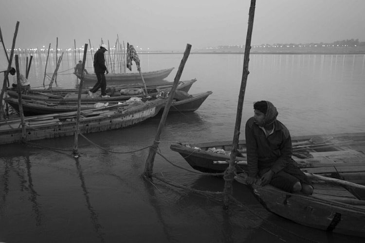 Ferryman awaits for people on the Ganges river in Allahabad India Moments Untold Stories Documentary Photodocumentary Ganges River Morning Portrait Humaninterest Blackandwhite