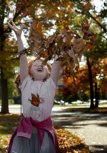 Tree Plant Autumn Human Arm Leaf One Person Nature Day Standing Childhood Arms Raised Child Limb Front View Focus On Foreground Celebration Girls Human Limb Outdoors Change Leaves Fall Seasonal Happiness Sunshine