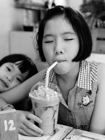 Food And Drink Childhood Real People Indoors  Drinking Straw Innocence Girls Table Drink Holding Focus On Foreground Sitting Lifestyles Leisure Activity Child Freshness Two People Togetherness Food Sweet Food WeekOnEyeEm EyeEmNewHere Ice Ice Green Tea