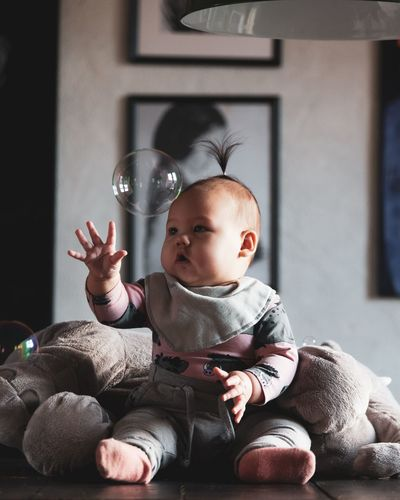 This year gone be awesome! Focus On Foreground Photography Photo Photographer Photograph Baby Photography Portraits Portrait Photography Photographing Babygirl Portrait Childhood Sitting Full Length Portrait Newborn Cute Babyhood Baby Innocence Close-up