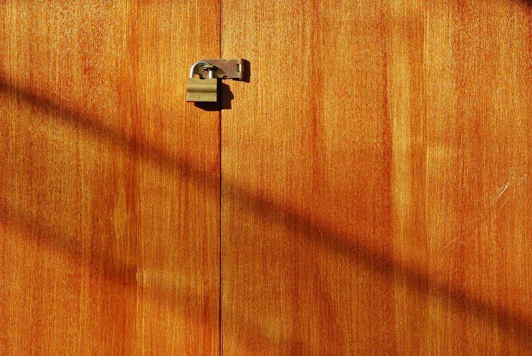 Close-up of lock on wooden door