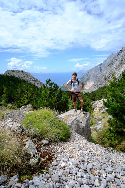 Croatia Adventure Beauty In Nature Biokovo Brela  Casual Clothing Cloud - Sky Day Full Length Leisure Activity Lifestyles Mountain Nature One Person Outdoors People Real People Rock - Object Scenics Sky Standing Tree Water Young Adult Young Men Young Women