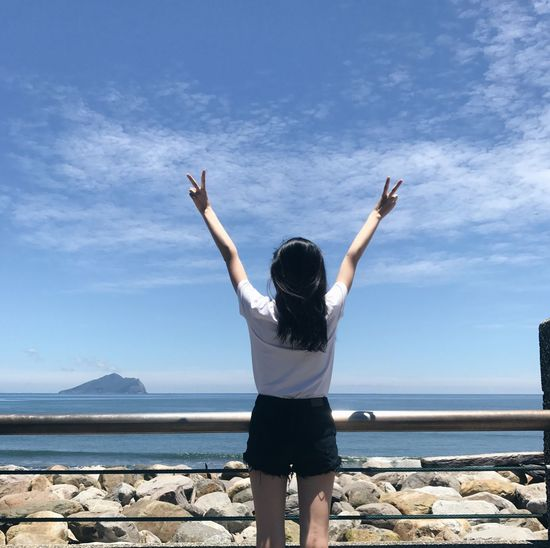 Real People Sky Rear View Sea Day Outdoors Arms Raised Lifestyles Water One Person Cloud - Sky Leisure Activity Nature Standing Scenics Women Horizon Over Water Mountain Beauty In Nature EyeEm Selects