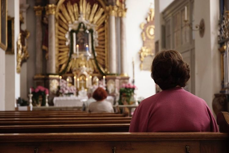 Rear view of a woman sitting in church
