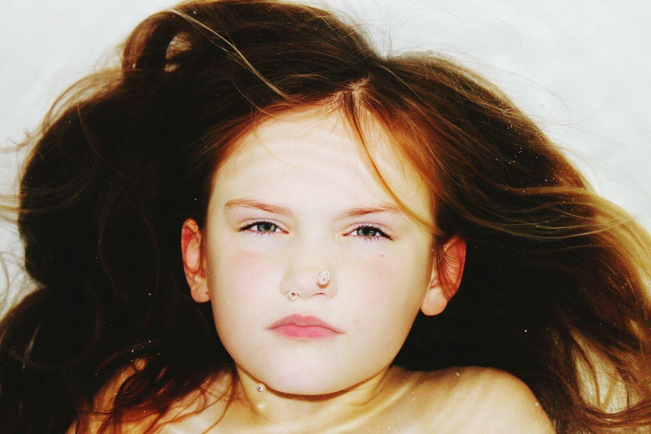 Close-up portrait of girl in bathtub