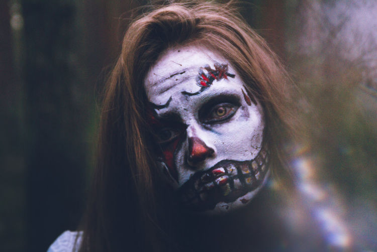 Portrait of woman with face paint