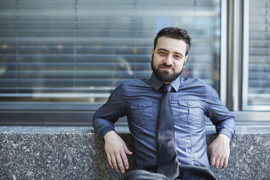 Beard Bench Blue Brazilian Business Business Man Day Entrepreneur Finance Handsome Looking At Camera Man Men Portrait Sitting Smiling Start Up Technology Urban Well-dressed Young Adult Young Man
