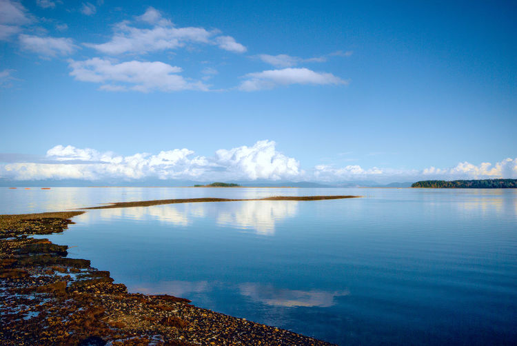 Reflections at Union Bay Beach Beauty In Nature Blue Cloud - Sky Day Horizon Over Water Landscape Nature No People Outdoors Reflection Scenics Sea Sky Tranquil Scene Tranquility Travel Destinations Vacations Water