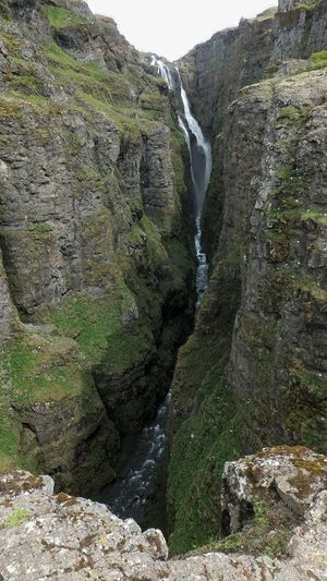 Glymur Waterfall Glymur, Iceland Glymur Glymurfoss Beauty In Nature Water Green Color Rocks Waterfall Vacations Landscape in Hvalfjörður, Iceland