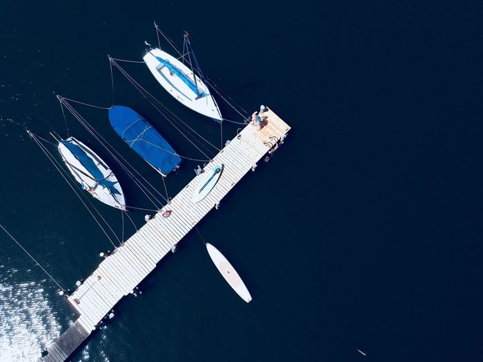 Sailboat in sea from high view angle