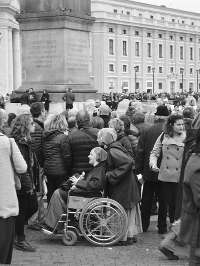 People standing in town square