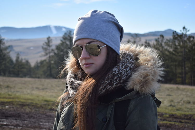 Exploring Beautiful Woman Beauty In Nature Close-up Cold Temperature Day Field Focus On Foreground Front View Girl Leisure Activity Lifestyles Mammal Mountain Nature One Person Outdoors Portrait Real People Sky Standing Warm Clothing Winter Young Adult Young Women
