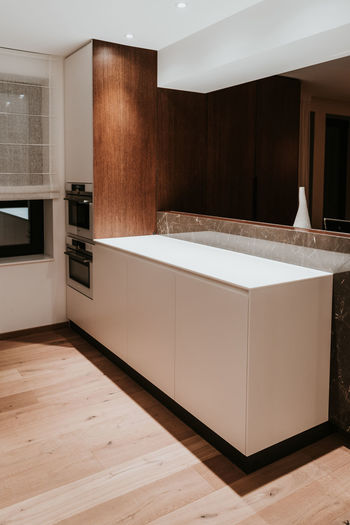 Domestic Room Indoors  Home Interior Modern Home Flooring Luxury Wealth Furniture No People Household Equipment Home Showcase Interior Kitchen Architecture Domestic Kitchen Wood - Material Wood Built Structure Sink Cabinet Tiled Floor