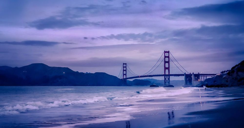 View of Golden Gate Bridge at Baker Beach in San Francisco Waves Blue Hour Sky Cloud - Sky Water Suspension Bridge Weather Nature Connection Outdoors Travel Destinations Mountain Bridge - Man Made Structure Built Structure Beauty In Nature Sea
