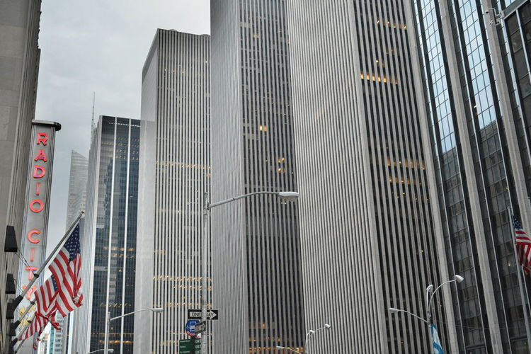 Architecture Built Structure City Building Exterior Office Building Exterior Building Modern Office Skyscraper Glass - Material Day Low Angle View No People Flag Tall - High Reflection Transportation Outdoors Sign Financial District  New York City