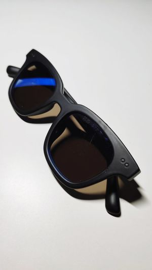 Close-up of sunglasses on table against white background