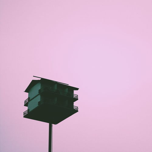 Low Angle View Of Birdhouse Against Clear Sky