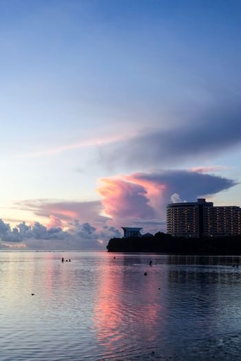 Sunset Guam Beach Sky Water Architecture Built Structure Building Exterior City Sunset Cloud - Sky Sea Skyscraper Waterfront Nature Beauty In Nature