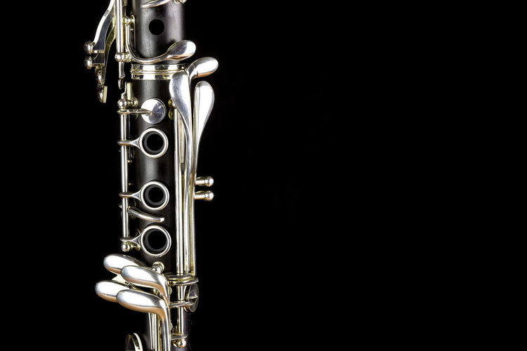 Music Instrument Clarinet, Clarinet Isolated on black Black Background Musical Instrument Studio Shot Arts Culture And Entertainment Music Brass Instrument  Brass Jazz Music Metal Wind Instrument Cut Out Copy Space Indoors  No People Trumpet Single Object Mystery Gold Colored Close-up Colored Background Silver Colored