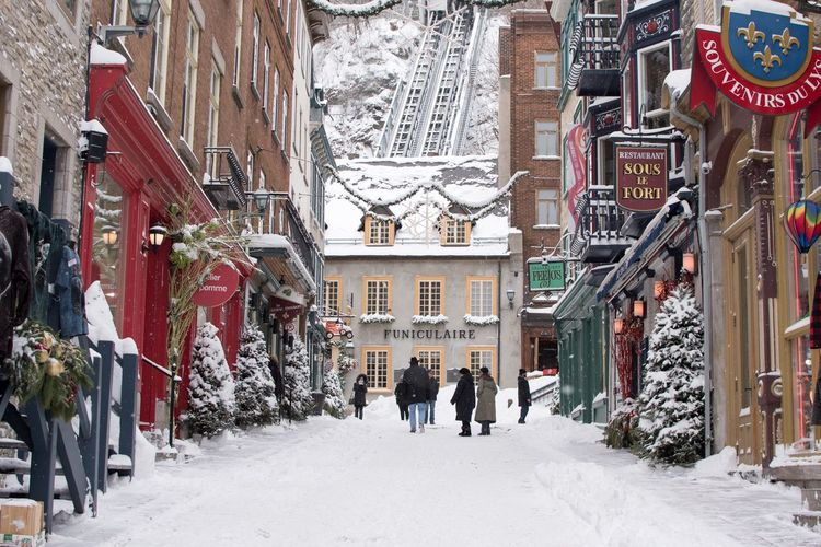 Villiage Quaint  Christmas Town Wide Angle French Christmas Decoration Town Winter Snow Walking Cold Temperature Building Exterior Architecture Built Structure Outdoors Day Real People Full Length City Nature People