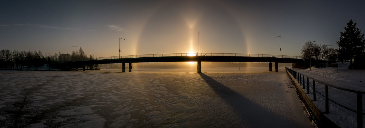 Halo at sunrise, downtown of Hämeenlinna. A cold sunday morning. Beauty In Nature Bridge Bridges Halo Nature Outdoors Reflection Sky Sky And Clouds Sky Collection Sunrise Sunrise_sunsets_aroundworld