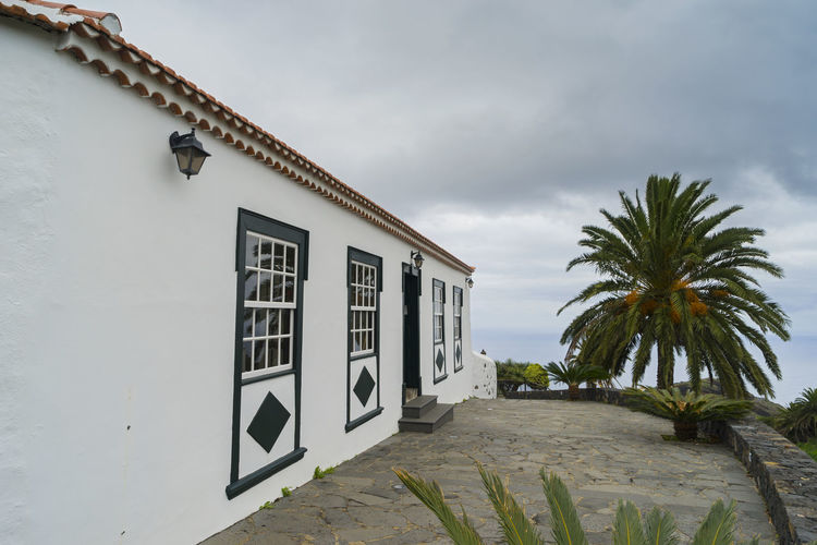 La Palma, Canarias Canary Islands SPAIN Travel Palm Tree Built Structure Building Exterior Sky Tropical Climate Plant Architecture Tree Cloud - Sky No People Nature Day Communication Building Outdoors Text Sign Low Angle View Lighting Equipment Western Script