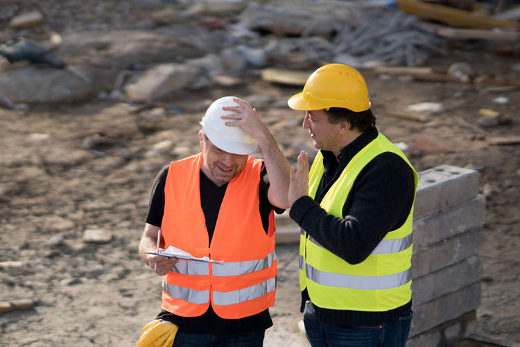 Cheerful architects at construction site