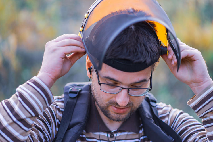 Young man wearing safety equipment