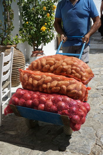 Carrying Greek Barbecue Carry Day Food Food And Drink Freshness Greece Healthy Eating Human Hand Meat Men One Person Onion Onions Outdoors People People And Places Real People Sausage Standing Vegetable Vegetables