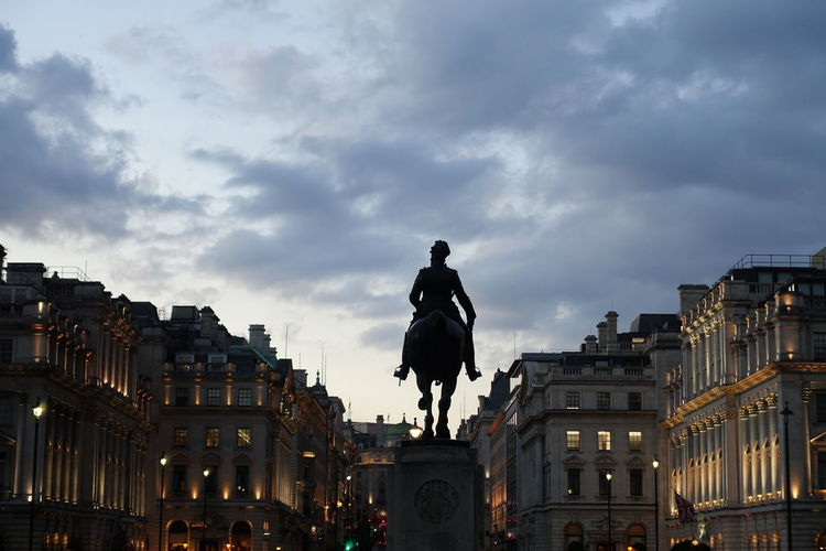 Old statue with building serving as a backdrop. Architecture Cityscape Horseback Riding Medieval Old Monuments One Man Only Outdoors Sculpture Statue