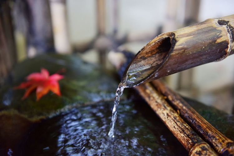 Close-Up Of Water Pouring From Shishi-Odoshi