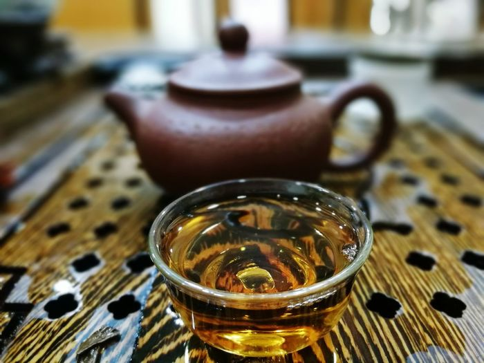 Close-Up Of Herbal Tea And Kettle On Table