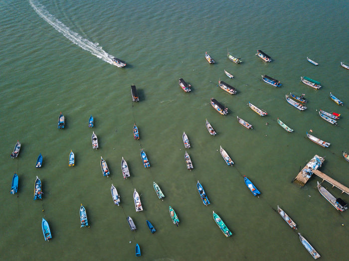 aerial view of fisherman boat headed to the jetty during evening. Aerial View Fisherman Boat Park Jetty Sea Ocean View Sky Fish Beach My Best Photo