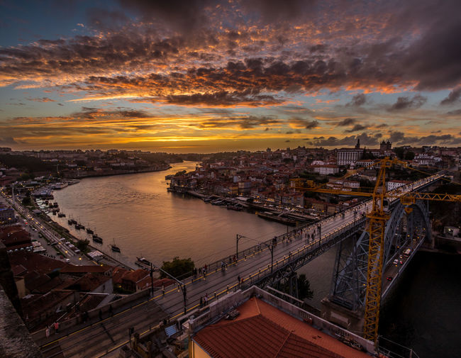 High angle view of bridge over river against sky at sunset