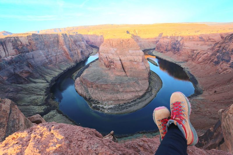 Low section of woman resting at horseshoe canyon