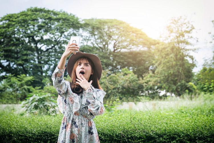Woman Taking Selfie At Park